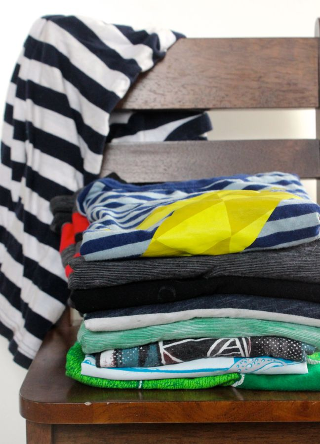 pile-of-t-shirts-stacked-on-a-chair