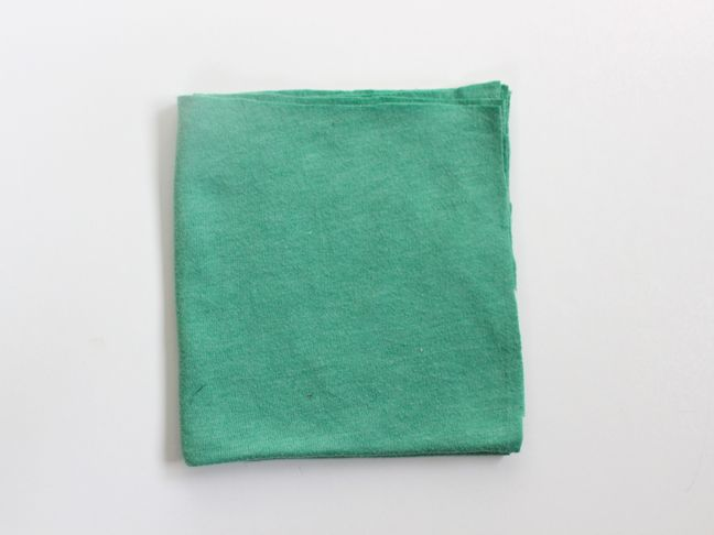 green-shirt-folded-into-a-square