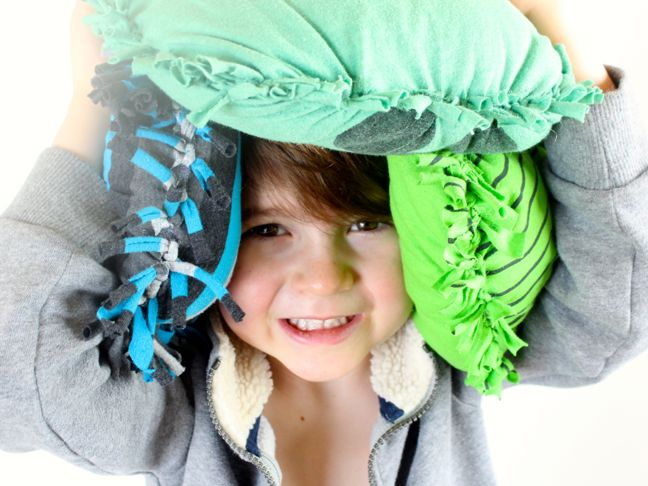boy-covered-in-pillows-pillow-fight-prep