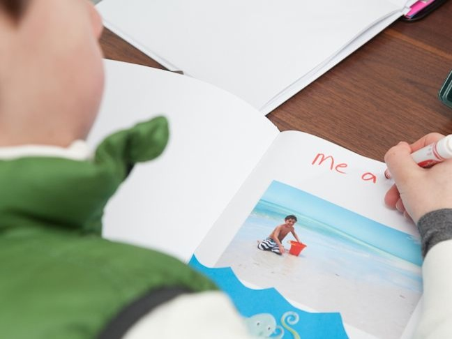 boy-scrapbooking-a-beach-vacation
