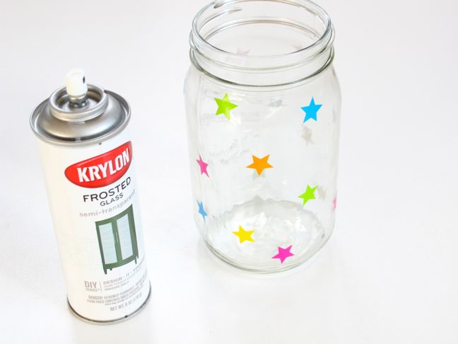 colorful-stars-on-a-mason-jar-next-to-a-can-of-frosted-glass-spray-paint