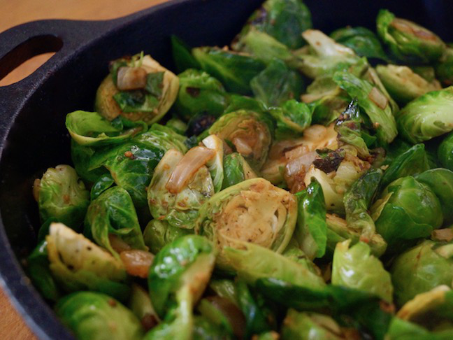 black pan-onion-green-brussels sprouts
