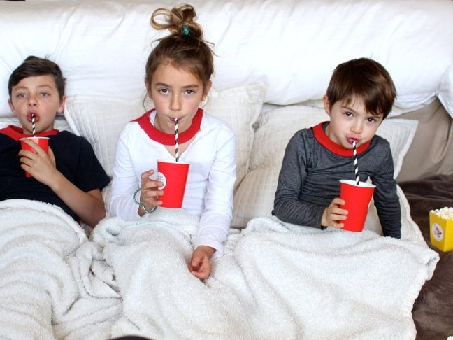 kids-sipping-striped-straws-under-blankets