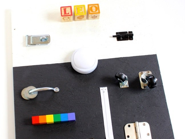diy-black-and-white-busy-board-with-hardware-and-letters-for-toddlers