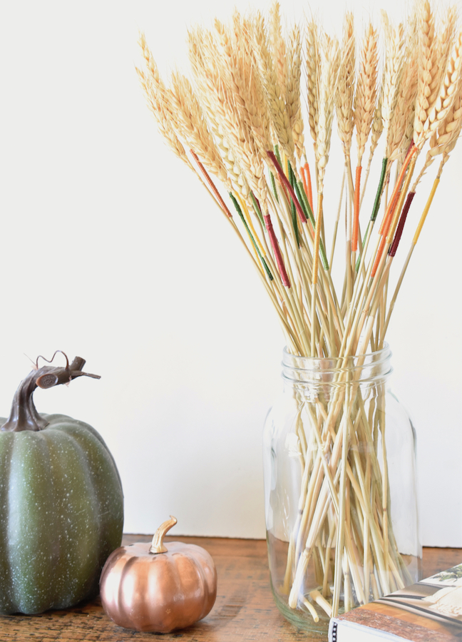 Add A Pop of Colour This Fall With Embroidery String On A Dried Wheat Arrangement