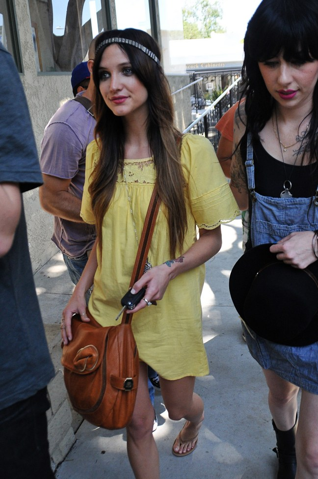 Ashlee Simpson Wentz yellow dress, flip flops, headband, brown purse