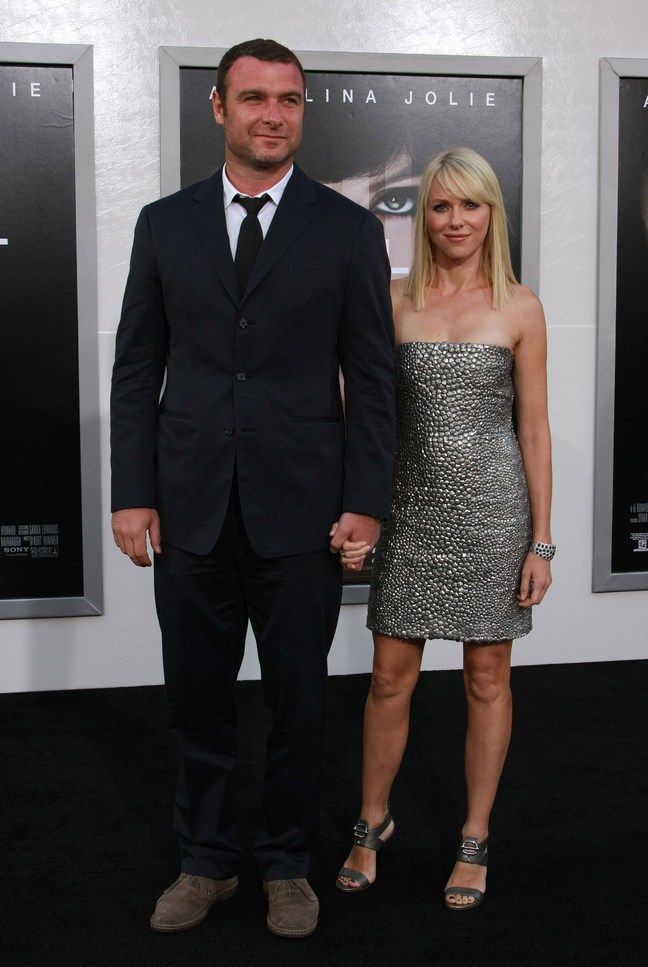 Naomi Watts silver mini dress, silver high heels, liev schreiber suit, brown shoes