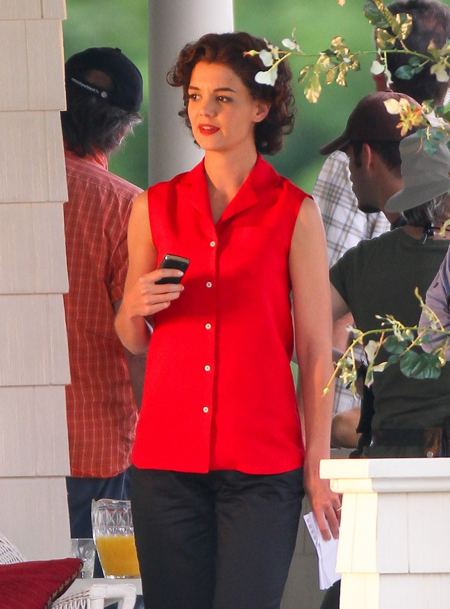 Katie Holmes, red sleeveless button down shirt, black slacks, cell phone