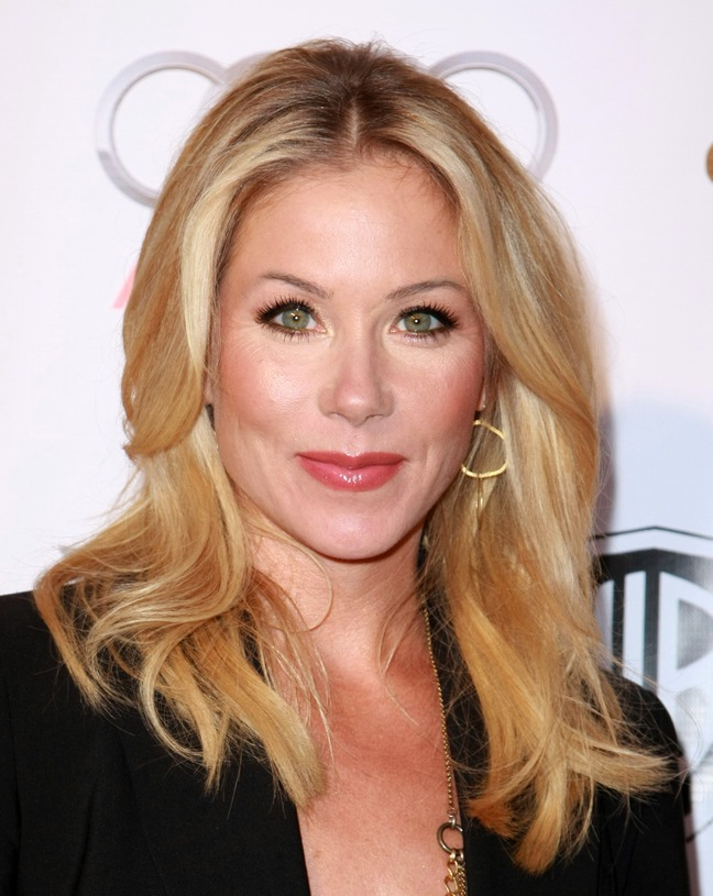Christina Applegate gold earrings, black blazer