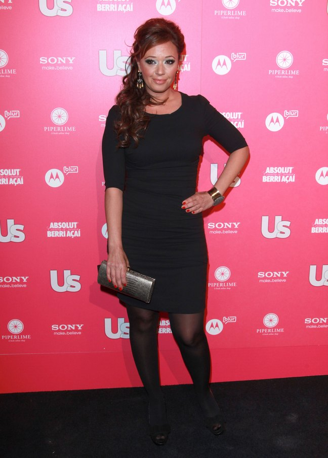 Leah Remini, black mini dress, silver clutch, upswept hair, bracelet, earrings