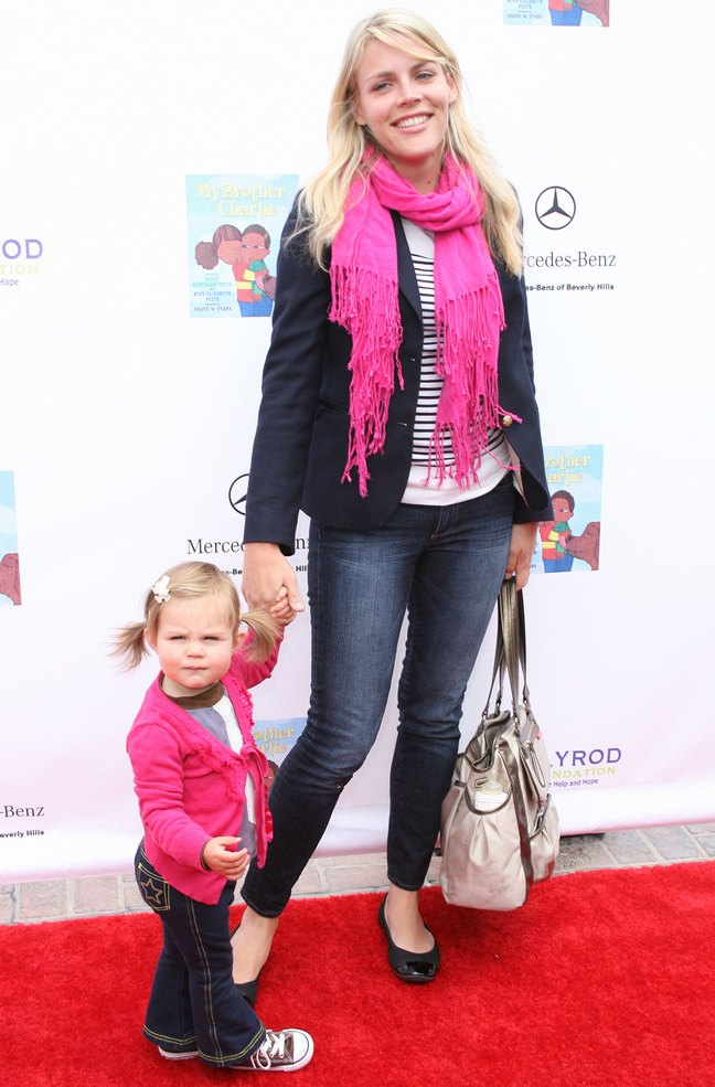 Busy Philipps, pink scarf, black flats, denim jeans, blazer, jacket, white bag, striped black and white top