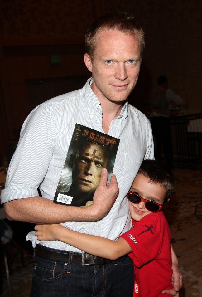 Paul Bettany, white shirt, denim jeans, son Stellan, red shirt