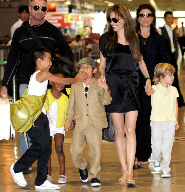Angelina Jolie, black silk mini dress, sunglasses, flip flops, Maddox, Pax, Zahara, Shiloh