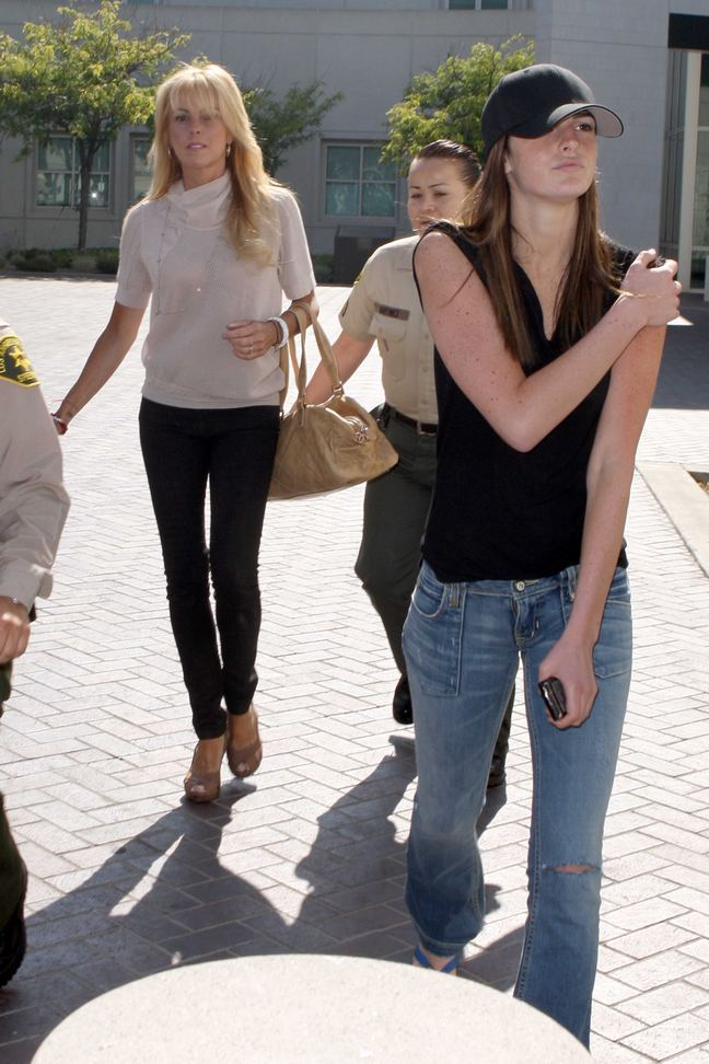 Dina Lohan, black pants, tan bag, bracelets, beige top, Ali Lohan, black tank top, jeans, black baseball hat