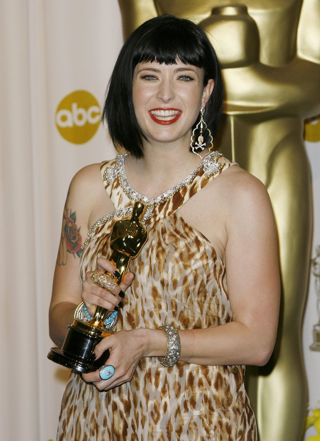 Diablo Cody, academy award, turquois ring, skull and bones earrings, animal print dress, bracelets