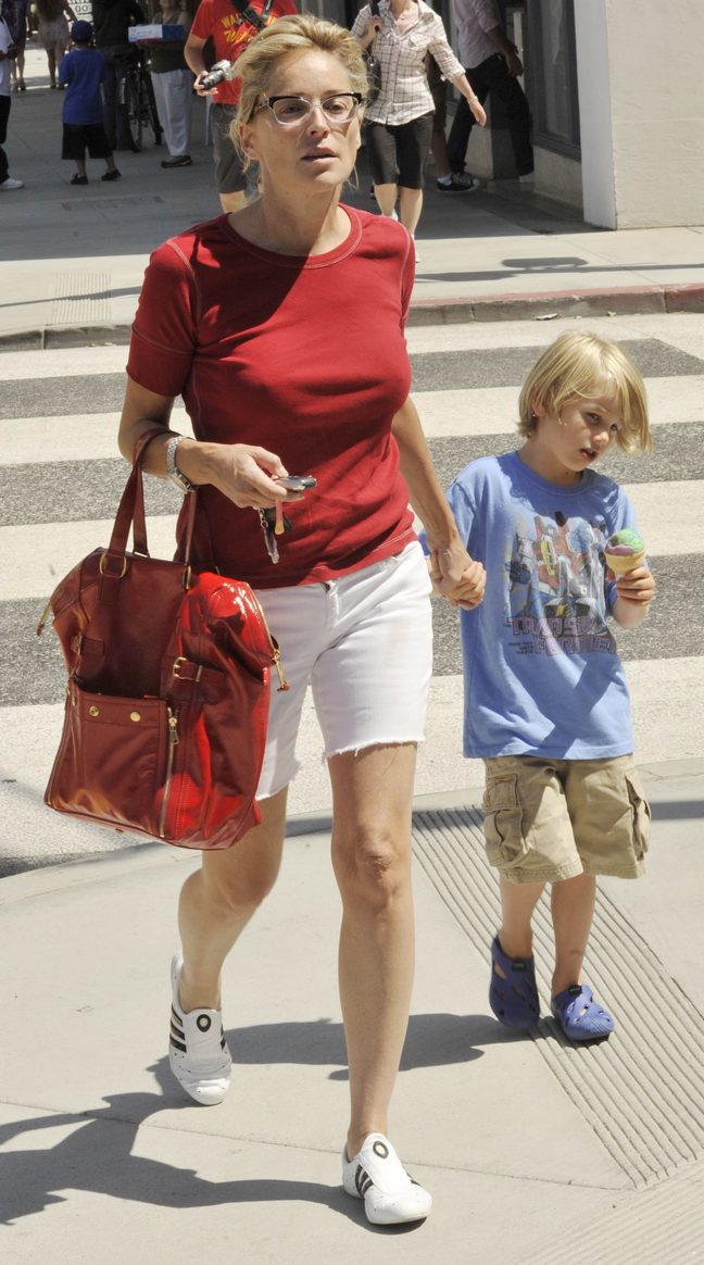Sharon Stone, eyeglasses, white shorts, red tshirt, tennis shoes, red tote bag, handbag, keys