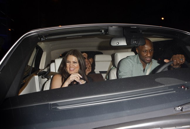 Khloe Kardashian, hoop earrings, black dress, Lamar Odom, green plaid shirt