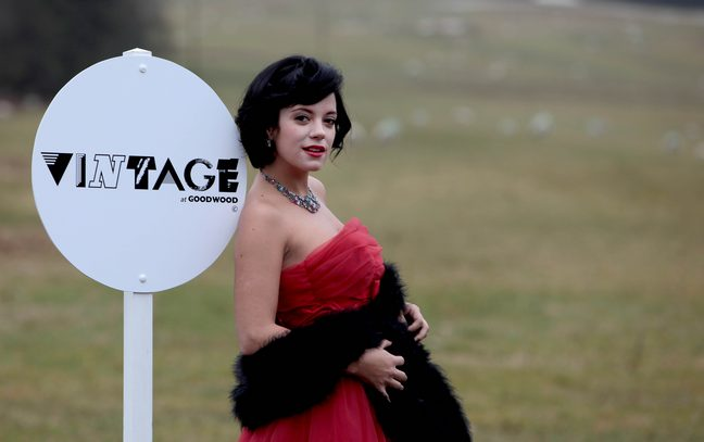 Lily Allen, red couture dress, necklace, fur wrap, shawl