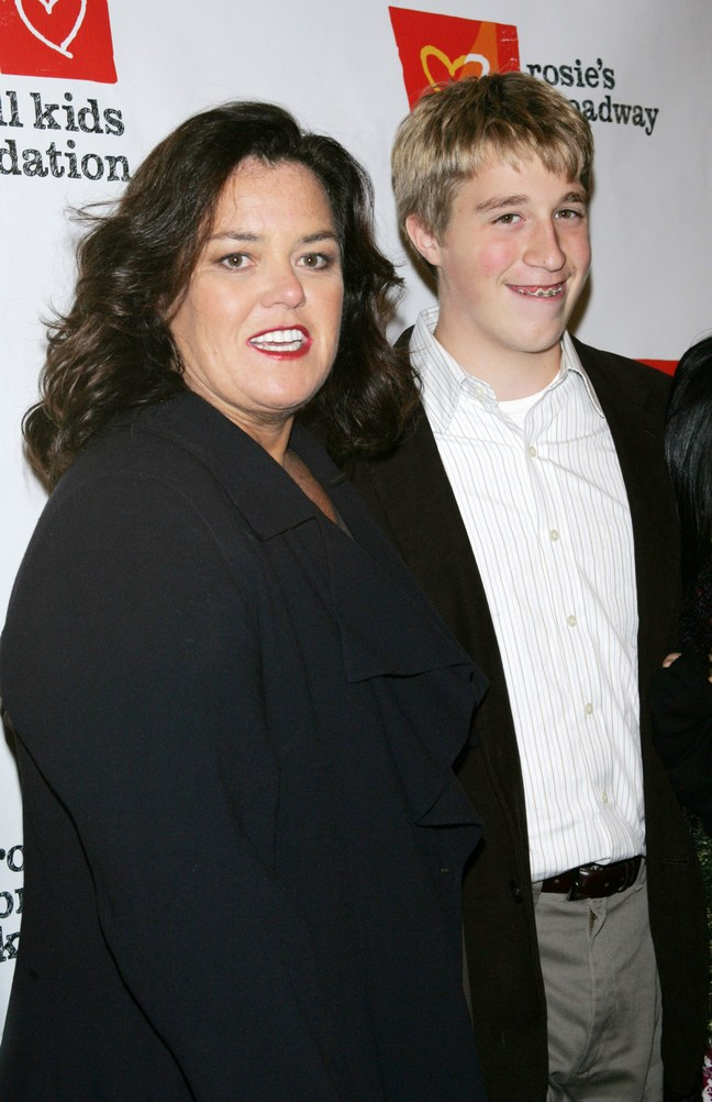 Rosie O'Donnell, black suit, Parker O'Donnell, suit jacket, gray slacks, white striped button down shirt, belt
