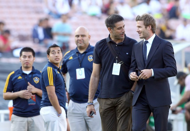 David Beckham, blue suit, soccer field,