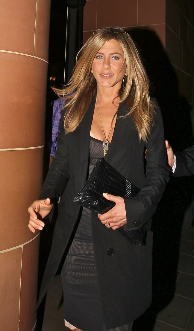 Jennifer Aniston, black trench jacket, black clutch, black and pink dress, high heels, necklace