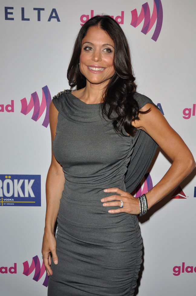 Bethenny Frankel, dark gray dress, silver bangle bracelets
