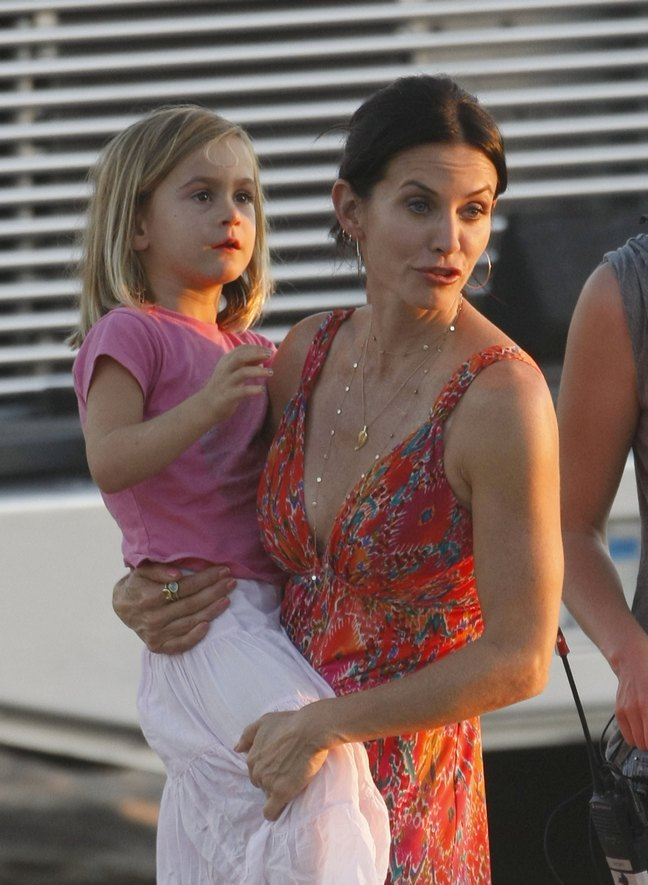 Courteney Cox, maxi floral print dress, hoop earrings, gold necklaces, Coco