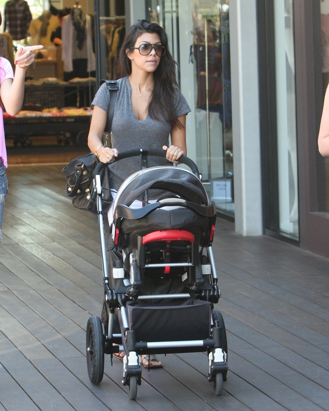 Kourtney Kardashian, flip flops, gray t-shirt, sunglasses, stroller, black purse