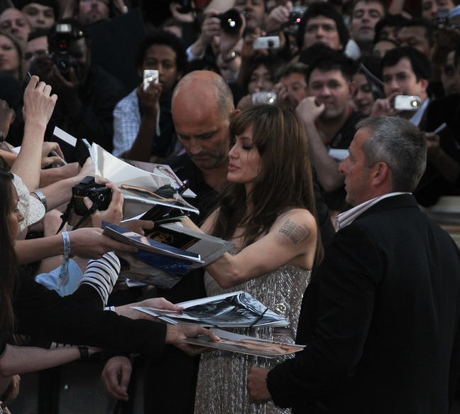 Angelina Jolie, gray silver dress with pink accents thigh slit, signing autographs, Salt premiere