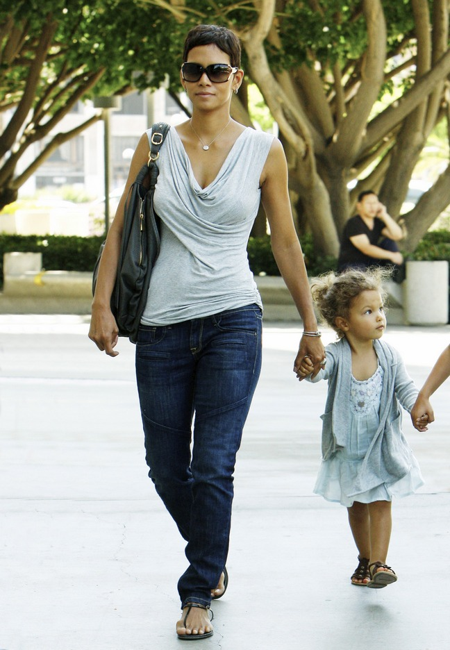 Halle Berry, gray swoop neck top, gray blouse, sunglasses, jeans, black purse, black tote
