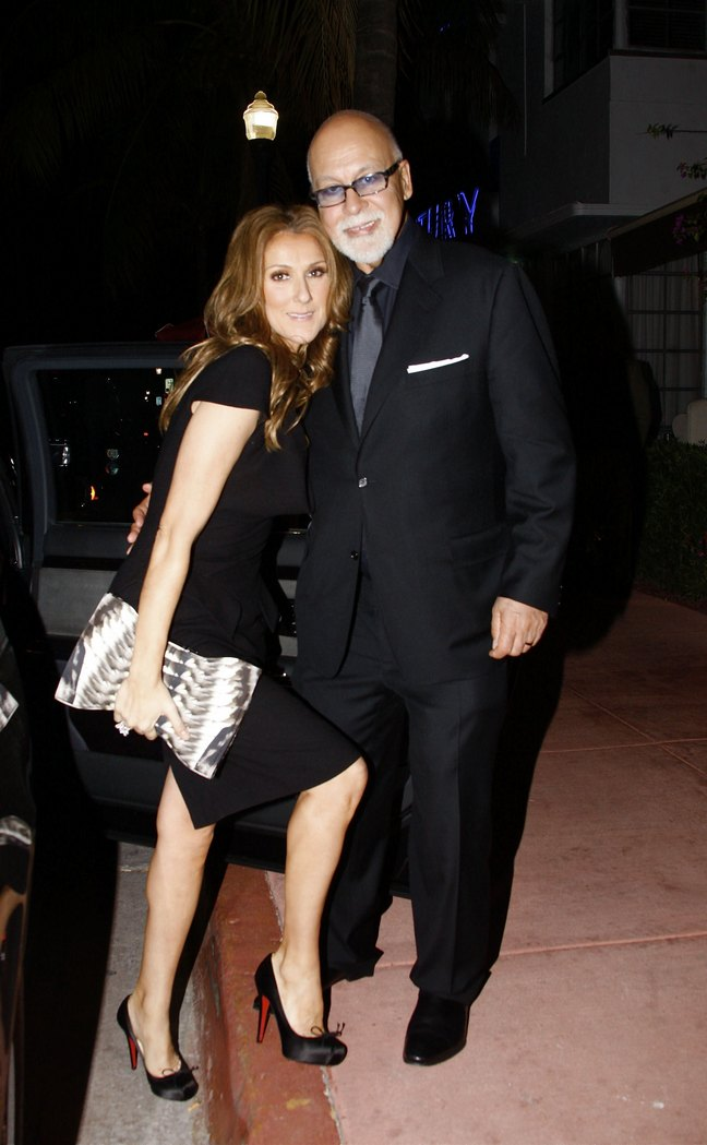 Celine Dion, black dress, heels, clutch