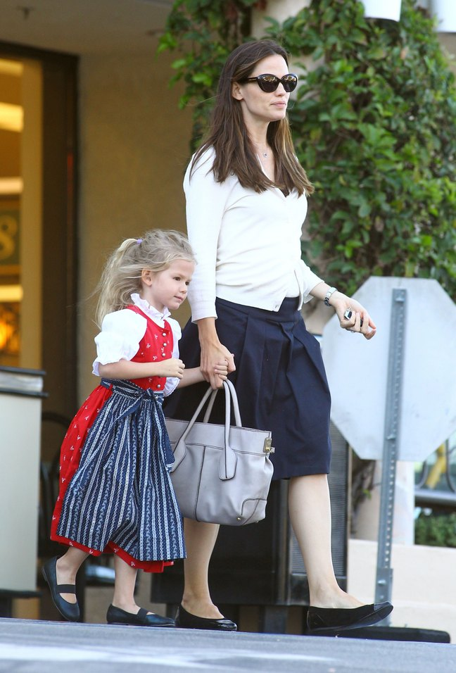 Jennifer Garner, black skirt, white sweater, black shoes, sunglasses, gray purse, watch