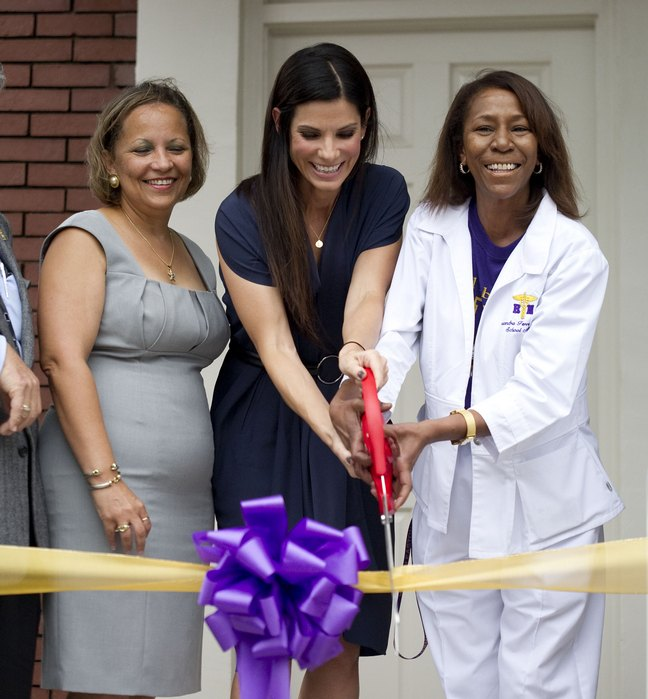 Sandra Bullock, ribbon cutting, navy dress, black heels