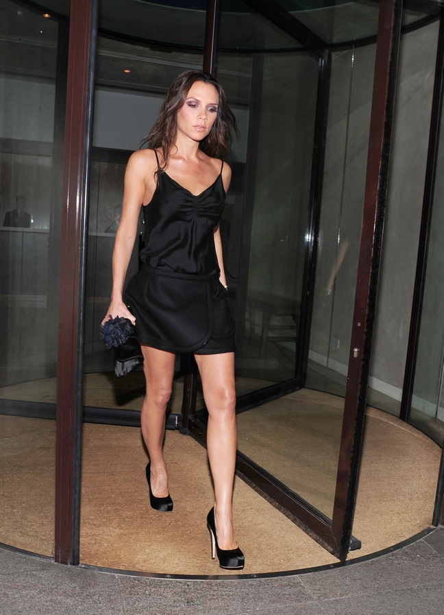 Victoria Beckham, black mini dress, black heels, watch