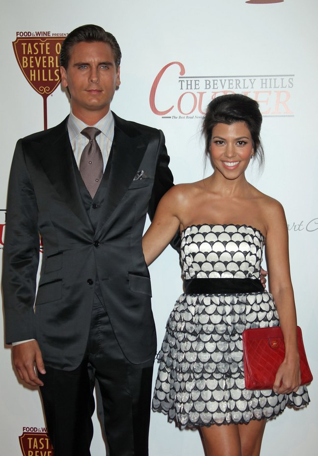 kourtney kardashian, black and white strapless dress, black belt, red clutch, scott disick, suit