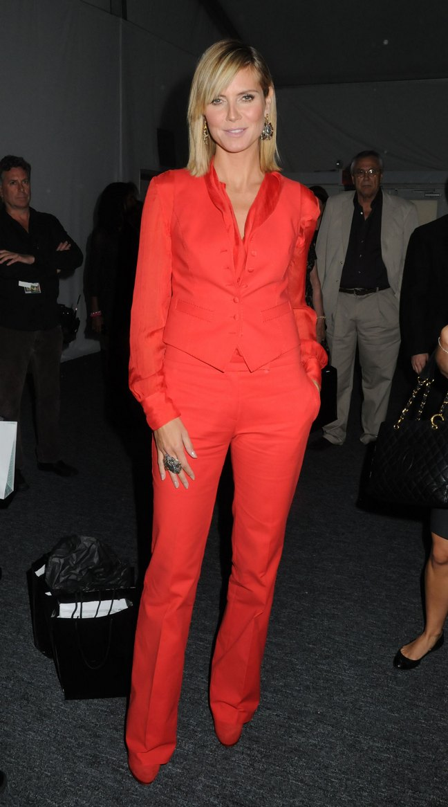Heidi Klum, red suite, red shoes, large ring, earrings, fashion week, project runway
