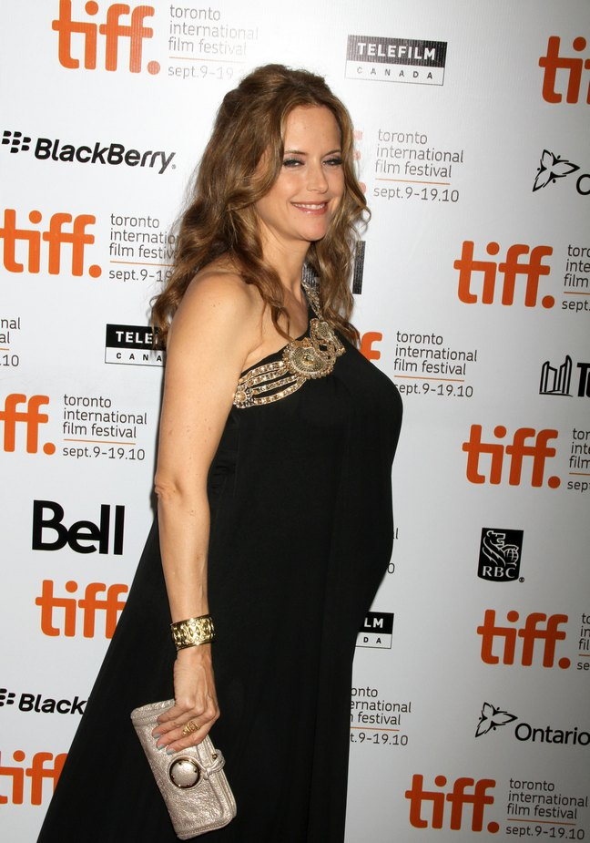 Kelly Preston, black dress with gold accents, pearl clutch, gold bracelet, gold cuff, Toronto Film Festival, Casino Jack