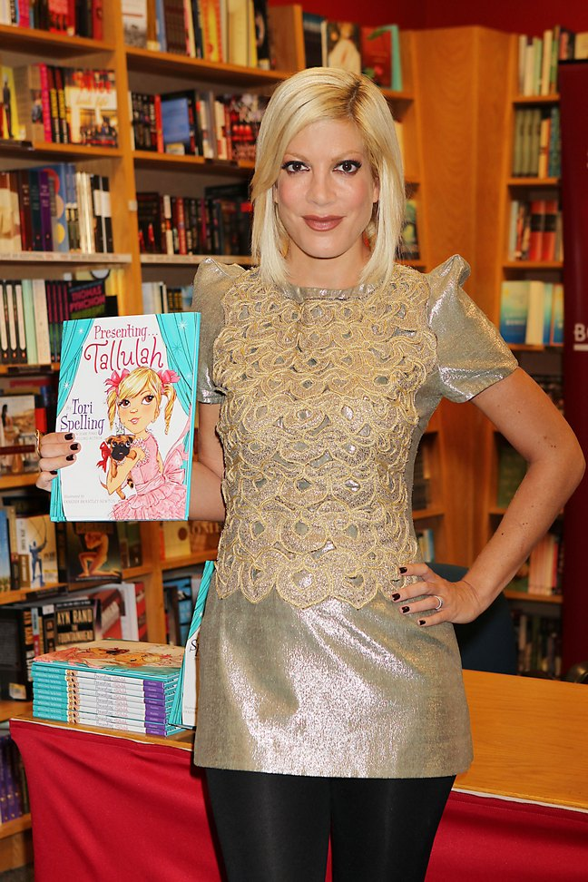 Tori Spelling, gold top, gold beaded shirt, black leggings, book signing, presenting tallulah