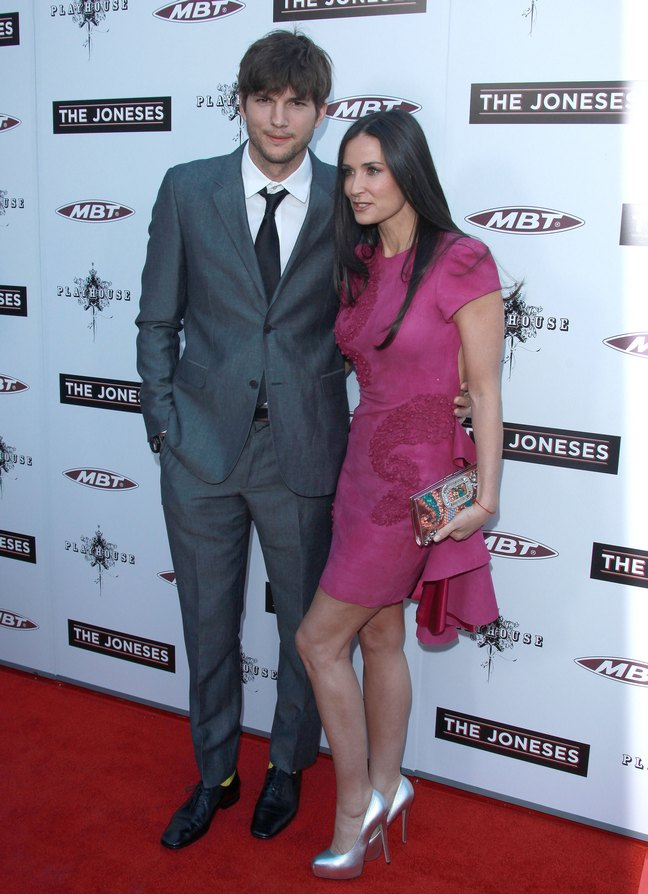 Demi Moore, pink dress, silver high heels, multi-colored clutch, Ashton Kutcher, gray suit, yellow socks