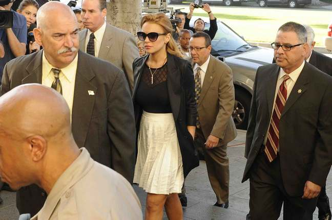 Lindsay Lohan, white skirt, black blouse, black jacket, sunglasses, courthouse, necklace