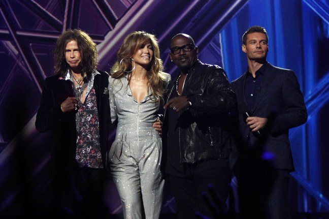 Jennifer Lopez, American Idol announcements, silver jumper, large silver hoop earrings, Steven Tyler, Randy Jackson, Ryan Seacrest