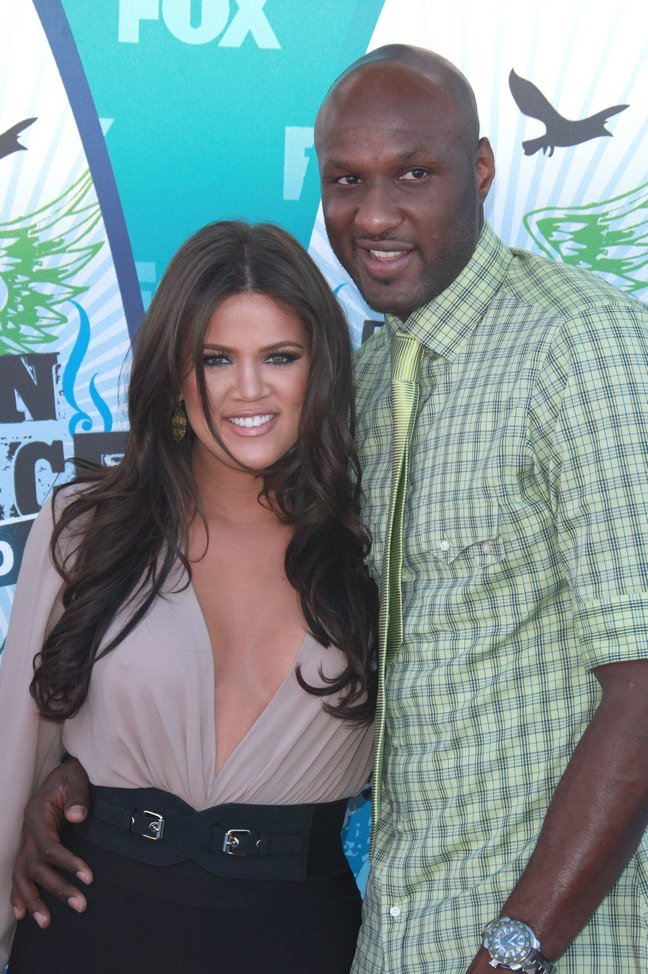 Khloe Kardashian, black skirt, black belt, beige blouse, Lamar Odom, green shirt, green tie, watch,