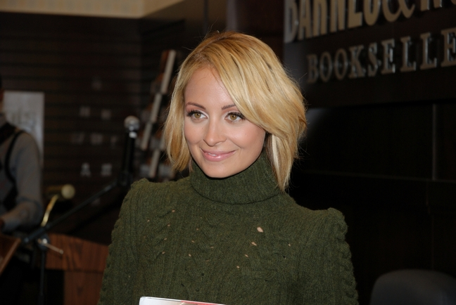 Nicole Richie, green sweater, book signing