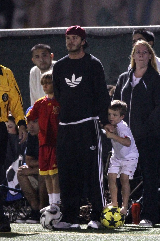 David Beckham, black addidas sweatshirt, track pants, black nylon pants