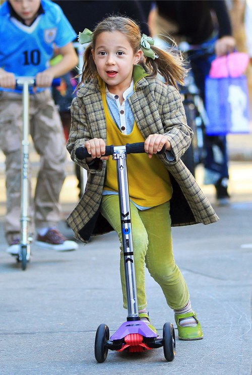 Ava Jackman, scooter, yellow sweater, green hair bows