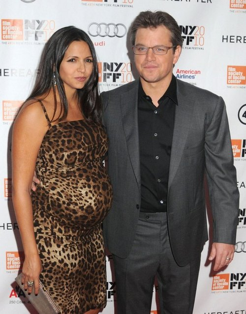 Matt Damon, gray suit, black shirt, glasses, Luciana Barroso, animal print dress, maternity dress