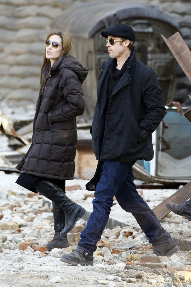 Brad Pitt, black jacket, black hat, jeans, black boots, Angelina Jolie, brown coat, black boots, sunglasses