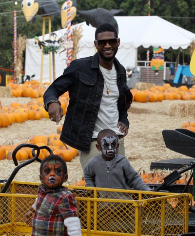 Usher Raymond, denim jacket, gray t-shirt, sunglasses, necklace
