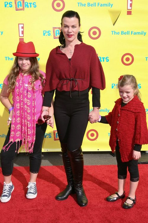 Debi Mazar, red blouse, black pants, black boots