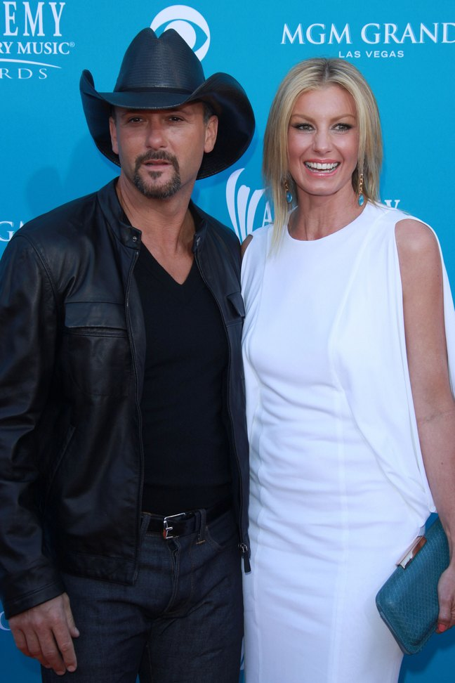 Faith Hill White dress, Tim McGraw Black jacket, black cowboy hat